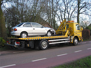 Plymouth-Indiana-flat-bed-tow-truck-service